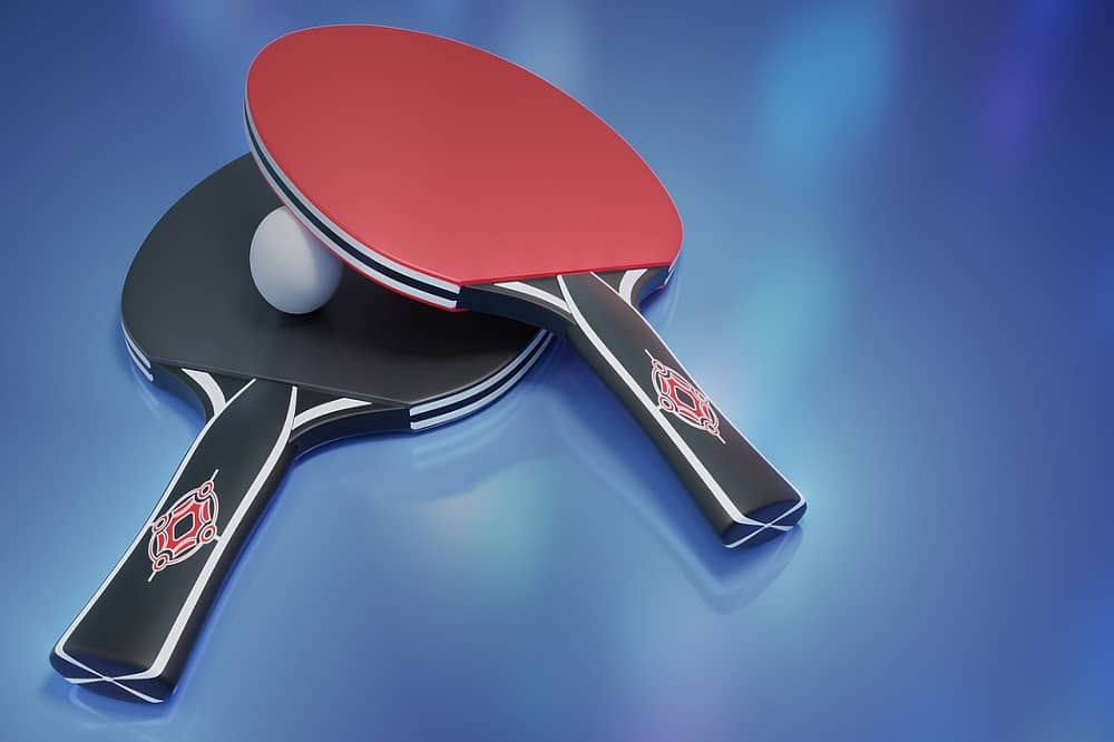 why are table tennis paddles black and red